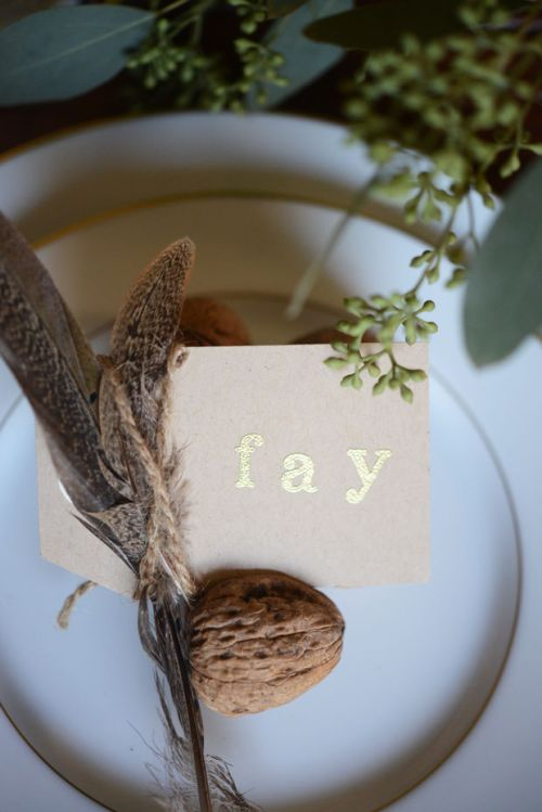 feathers and chestnut table setting