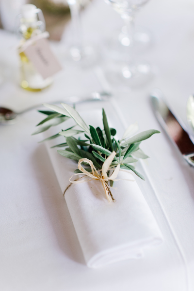 white table with herb sprig